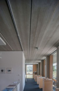 Blue-Office: The ground-floor open-plan office ceiling are 15,5 m long reinforced-precast-concrete-slabs