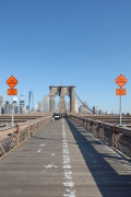 Brooklyn Bridge: pedestrian catwalk facing Manhattan, traffic-signs