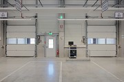 ebm-papst: inside logistic-center, loading-ramp sectional-gate, landscape