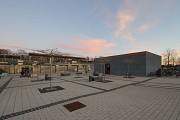 Erftstadt railway station: north-western view of cycle-station - dusk