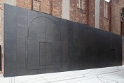 European Hansemuseum: bronze-wall showing 3 side-chapel section-rieliefs