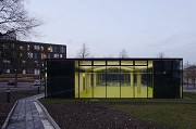 glass-cladded textile-concrete pavillon: Southern view at dusk