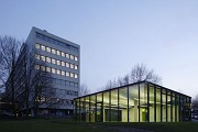 glass-cladded textile-concrete pavillon: Northeastern view at dusk