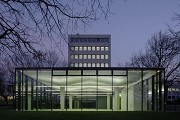 glass-cladded textile-concrete pavillon: Northern view at dusk