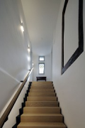 Tebartz-van Elst: frame house: staircase from lobby up to first floor