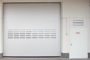 Novoferm tormatic: outer rolling gate with esacape-door